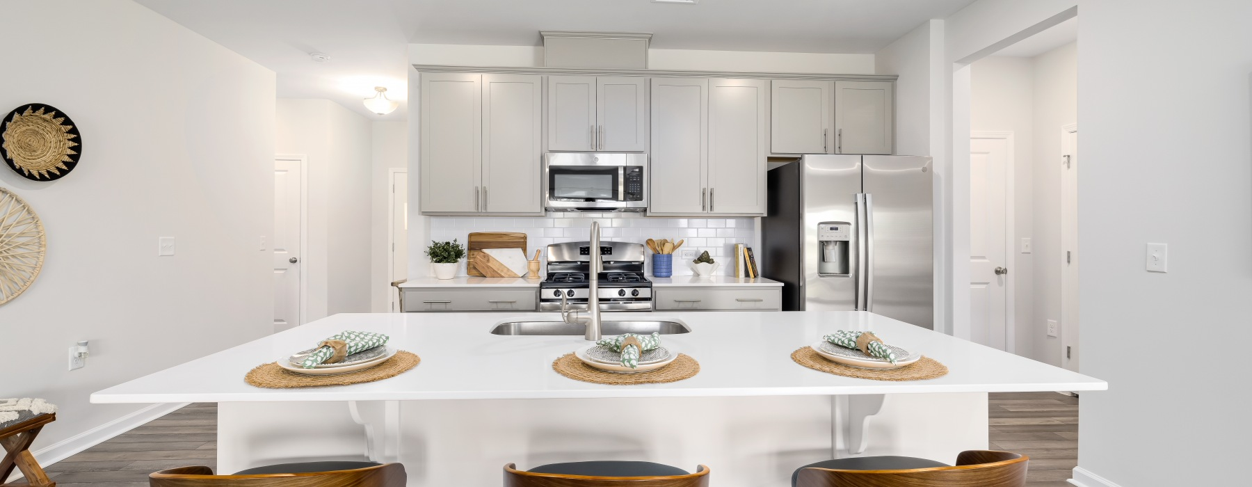 Kitchen with quartz countertops, gray cabinets and stainless steel appliances